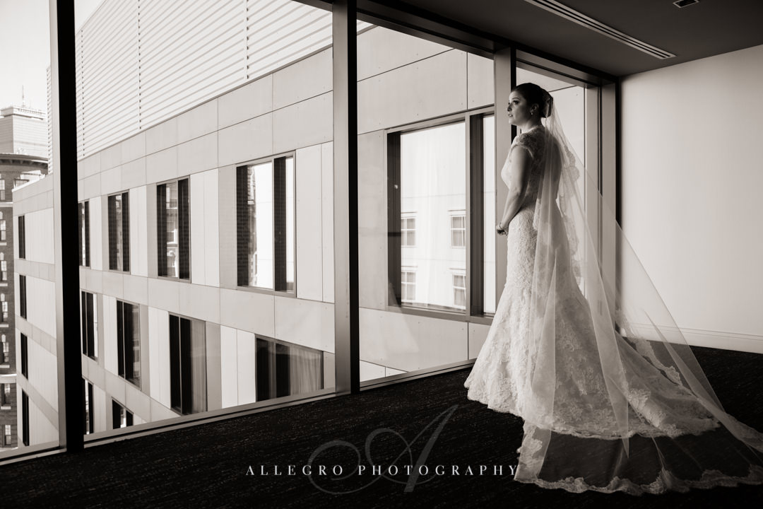 bridal portrait overlooking boston at the hotel commonwealth - photo by allegro photography