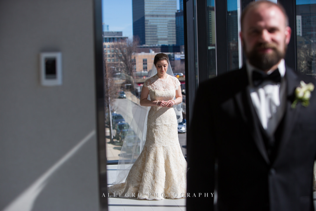 grooms first look at the hotel commonwealth boston - photo by allegro photography