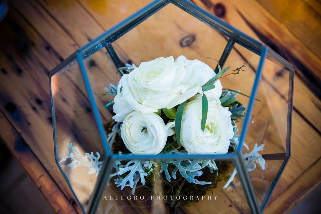 white and green floral wedding arrangements at mirbeau inn & spa - photo by allegro photography