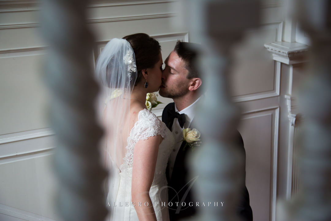 sneaky wedding kiss at the pierce house - photo by allegro photography