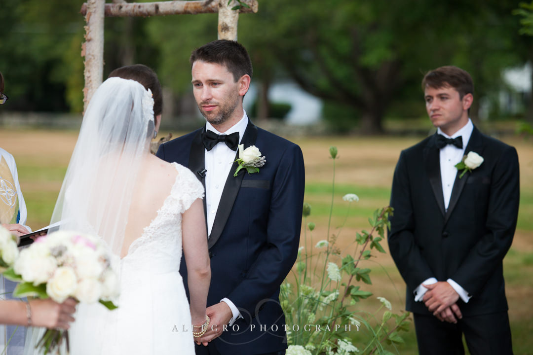 groom saying vows at the pierce house - photo by allegro photography