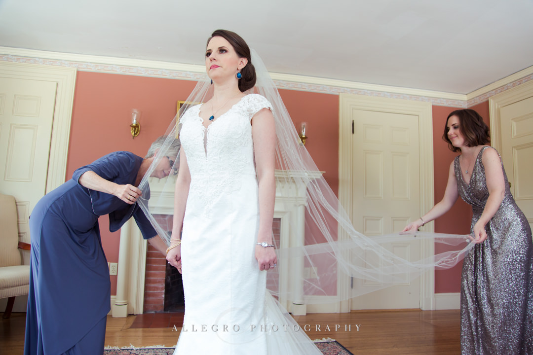 bride getting ready for her boson wedding - photo by allegro photography