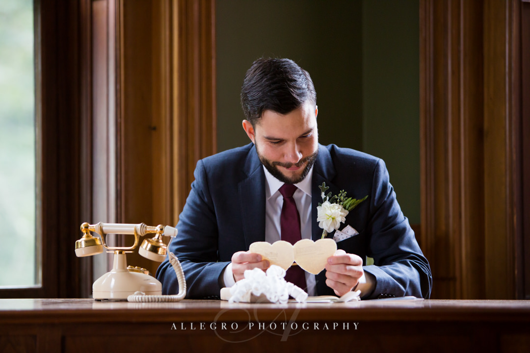 groom reading wedding day love letter boston - photo by allegro photography