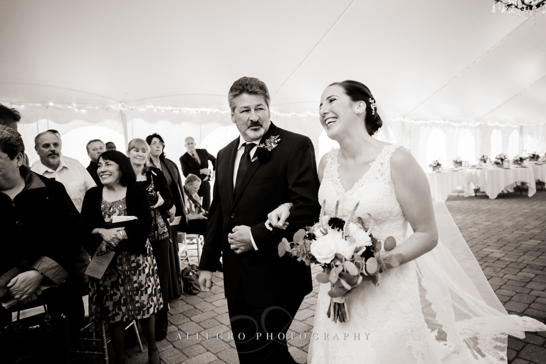 bride walking down the aisle at the stevens estate - photo by allegro photography