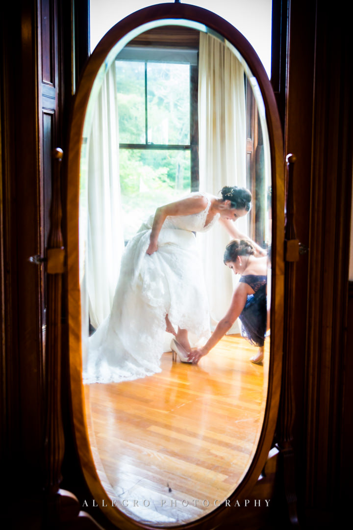 sweet bridesmaid helping the bride at the stevens estate - photo by allegro photography