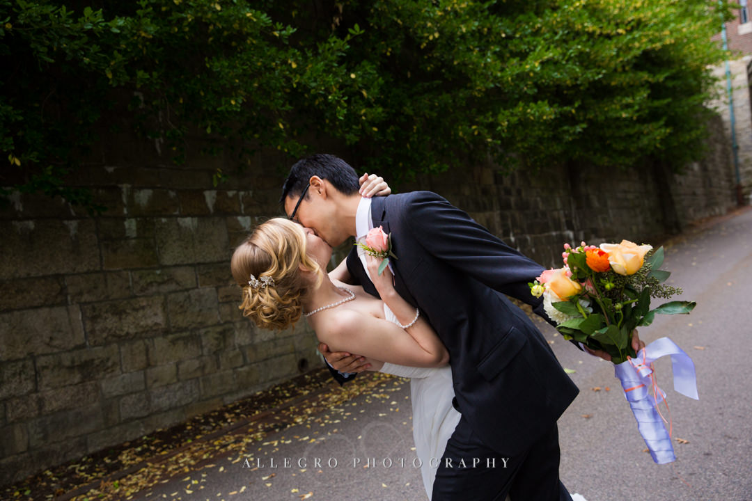 surprise wedding kiss at wellesley college - photo by allegro photography
