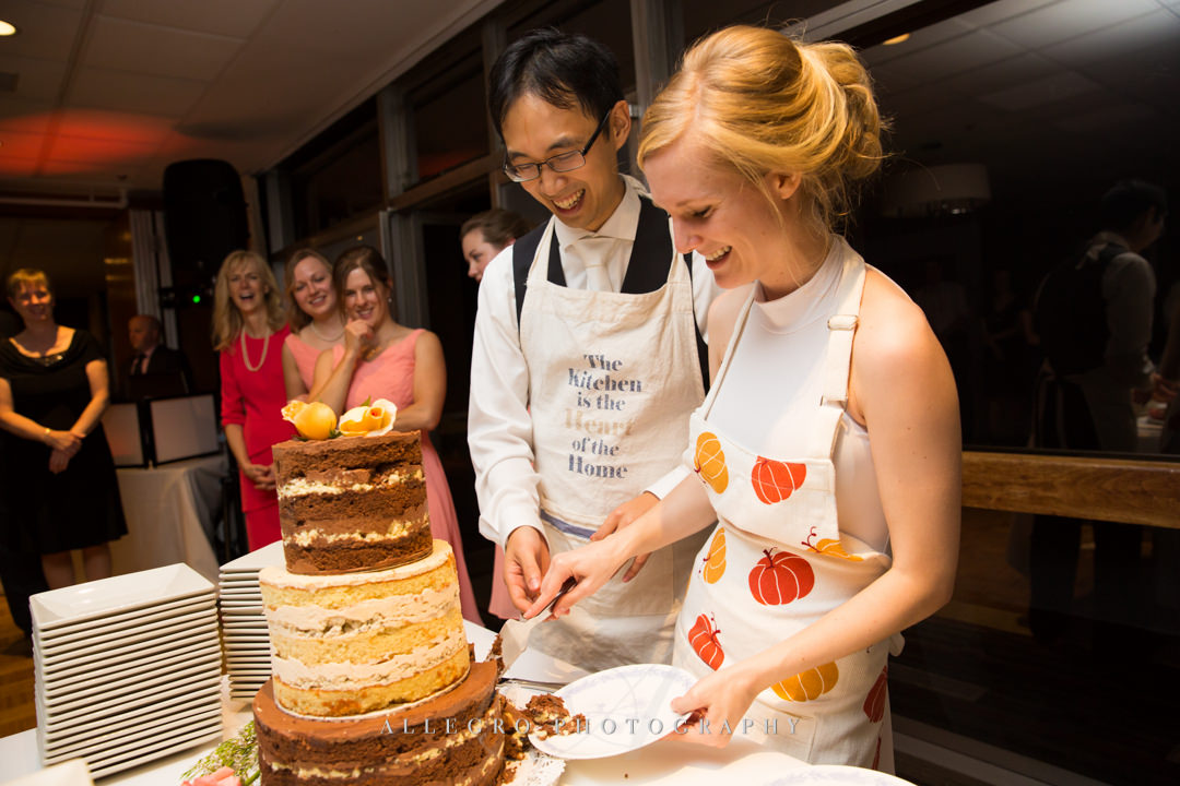 cutting the cake at wellesley college club - photo by allegro photography