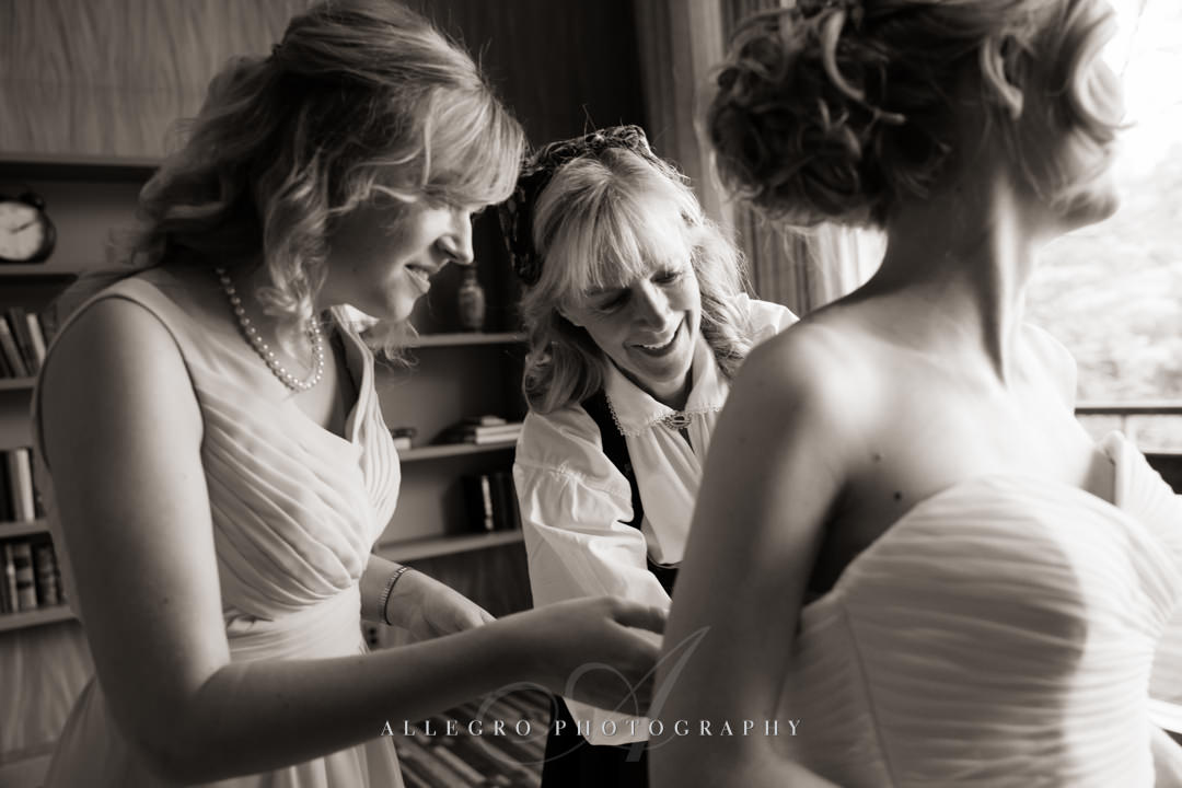 zipping up the wedding dress at the wellesley college club - photo by allegro photography