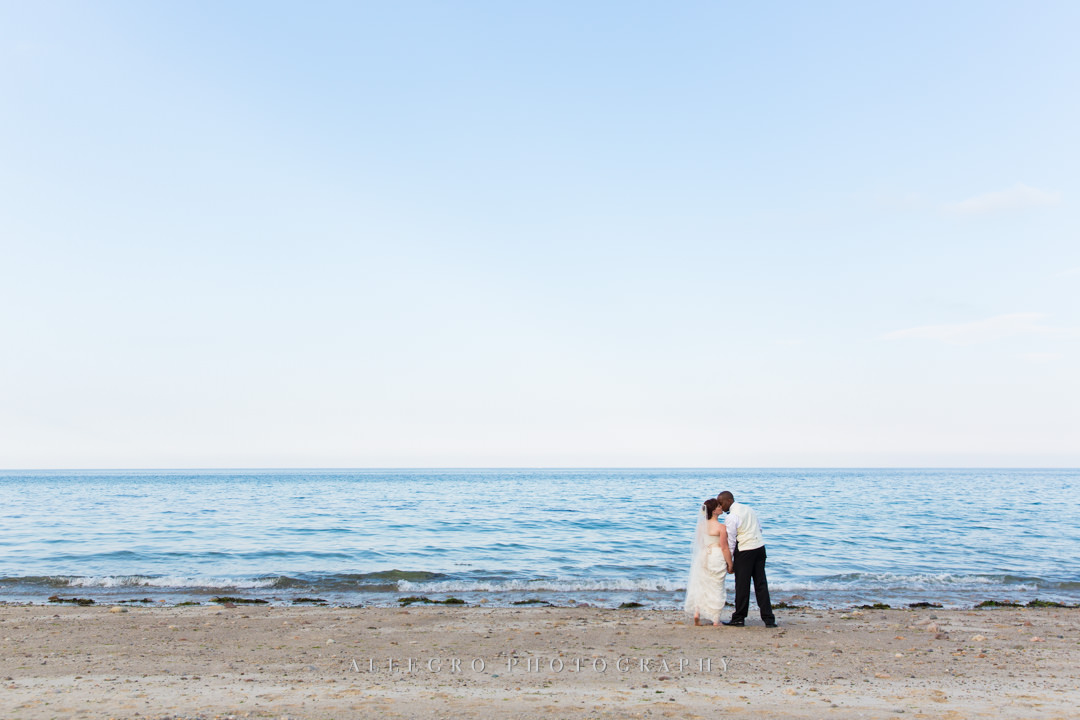 beach wedding first kiss - photo by allegro photography
