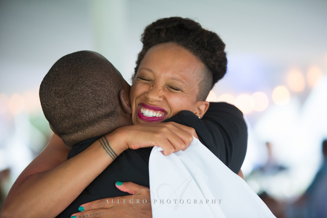 wedding reception hugs - photo by allegro photography
