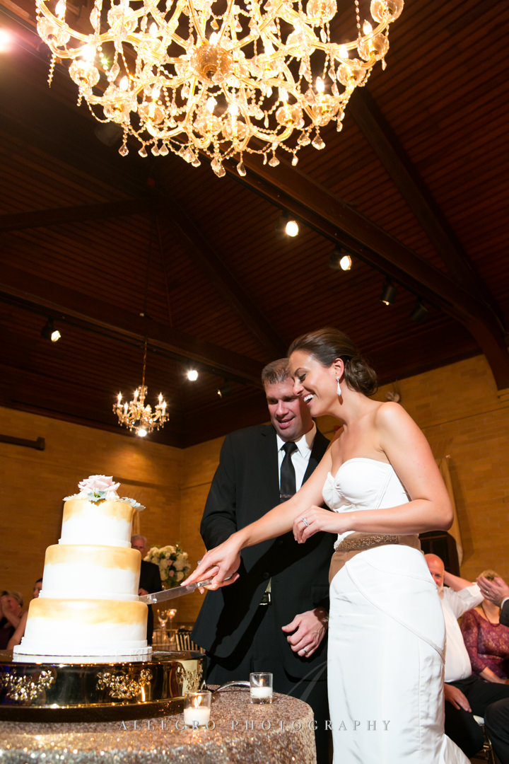 wedding reception cutting the cake linden place - photographed by allegro photography