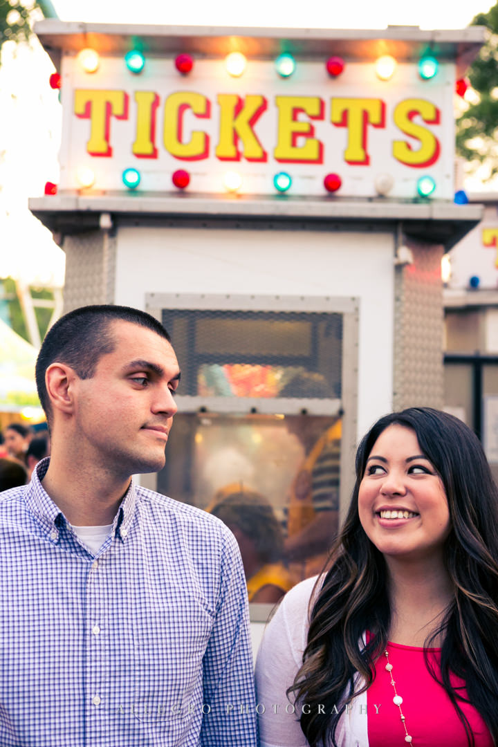 carnival engagement photo - photographed by allegro photography