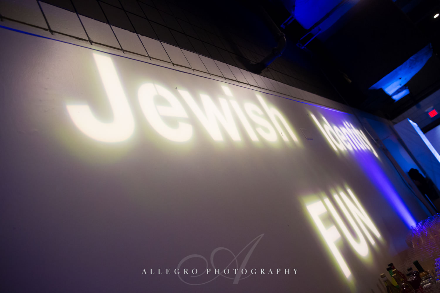 Projection decor at nonprofit event shot by Allegro Photography