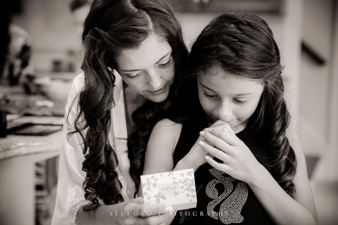 allegro photography photo: bride and flower girl read a note getting ready in needham ma