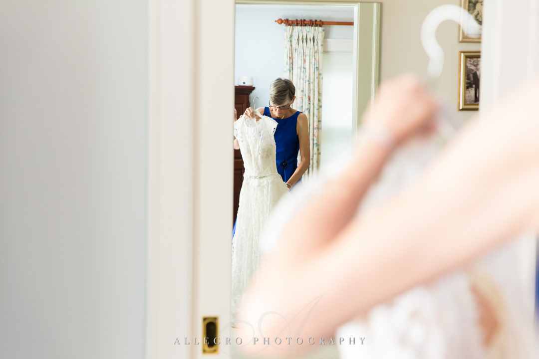 allegro photography: mob holding her wedding dress before elm bank wedding