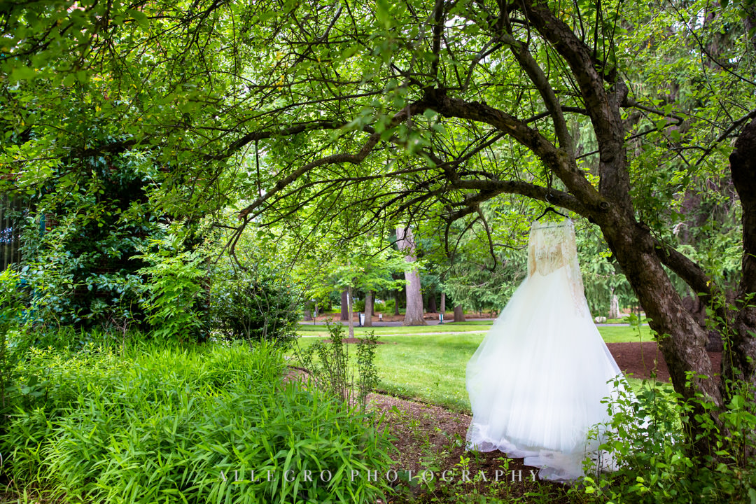 Wedding dress hanging from tree | Allegro Photography