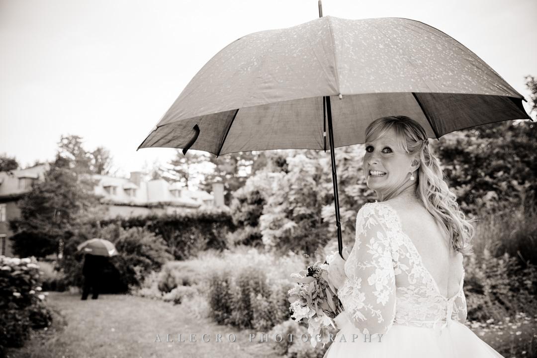 Bride holding an umbrella at Elm Bank Gardens | Allegro Photography