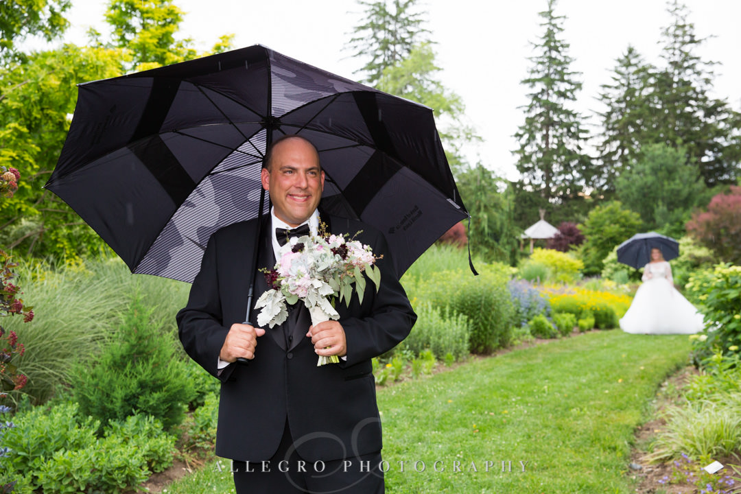 Bride and groom first look on rainy day | Allegro Photography