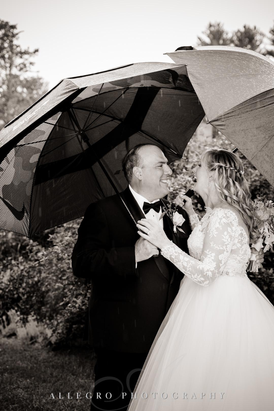 Bride and groom under umbrella | Allegro Photography