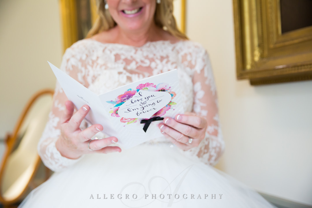 Bride to be reading groom's card | Allegro Photography