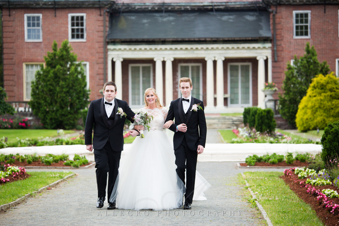 Sons walk bride mother down the aisle | Allegro Photography