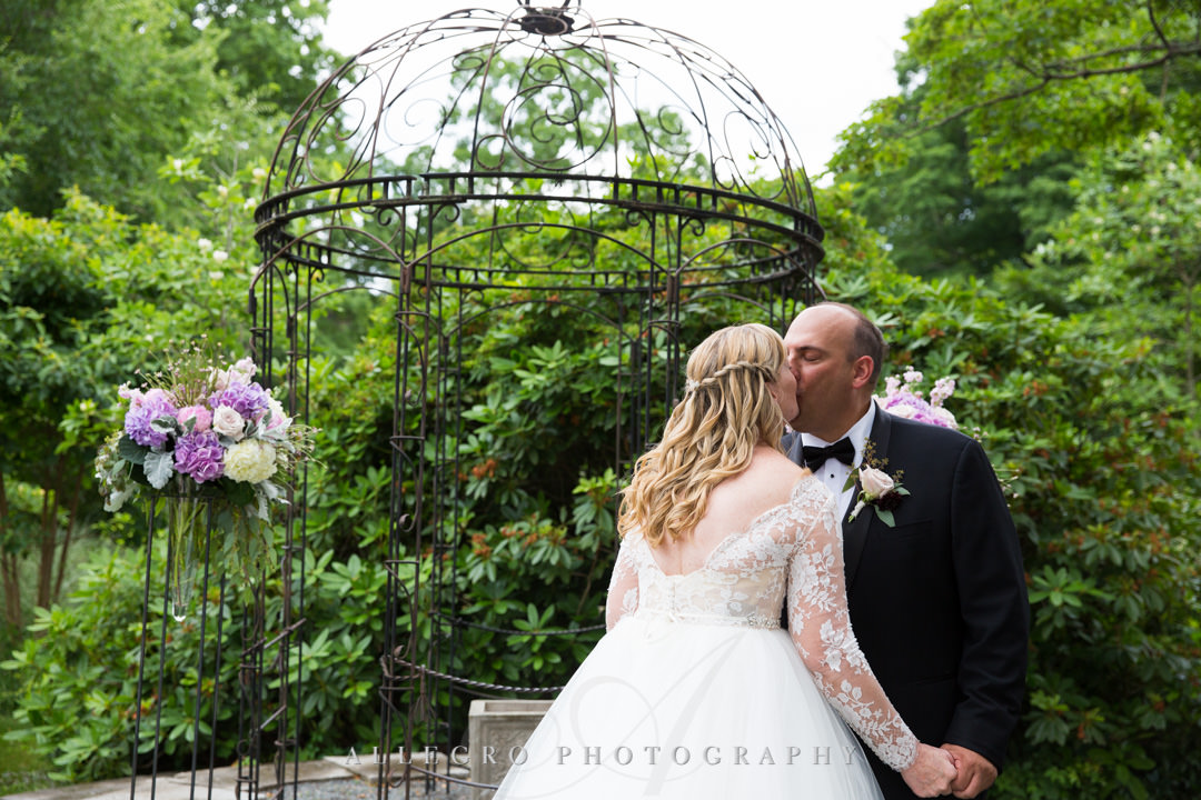 Bridge and groom kiss at Gardens at Elm Bank wedding | Allegro Photography
