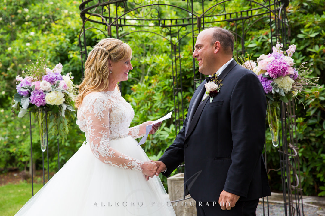 Bride says vows to husband at Gardens at Elm Bank | Allegro Photography