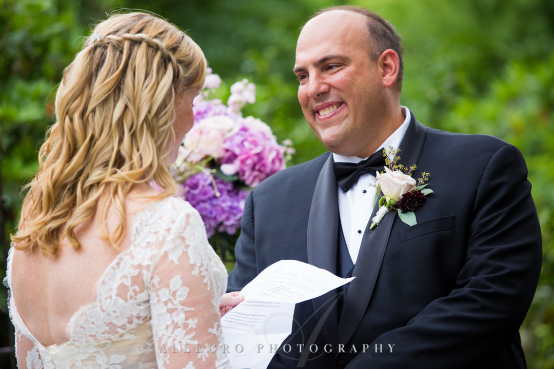 Groom smiles as his bride reads him her vows | Allegro Photography