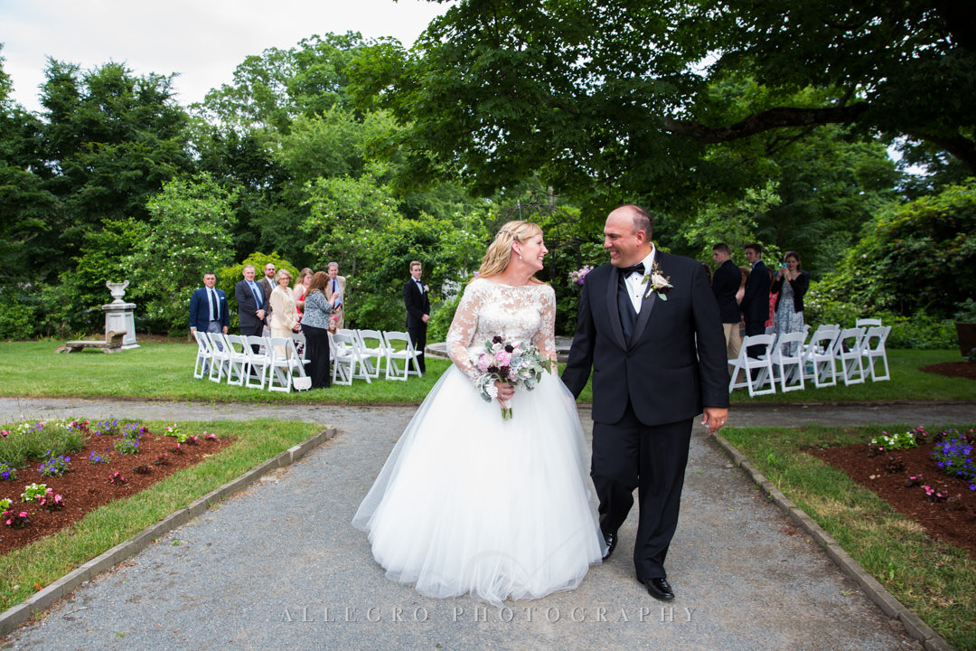 Newlyweds walk down the aisle | Allegro Photography