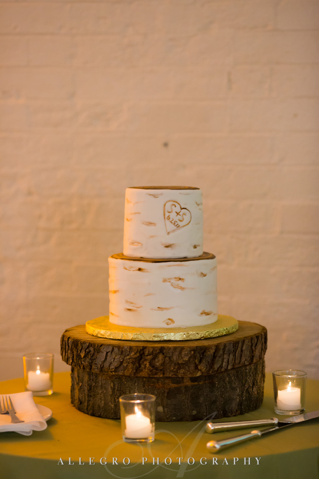 Two-tiered white wedding cake | Allegro Photography