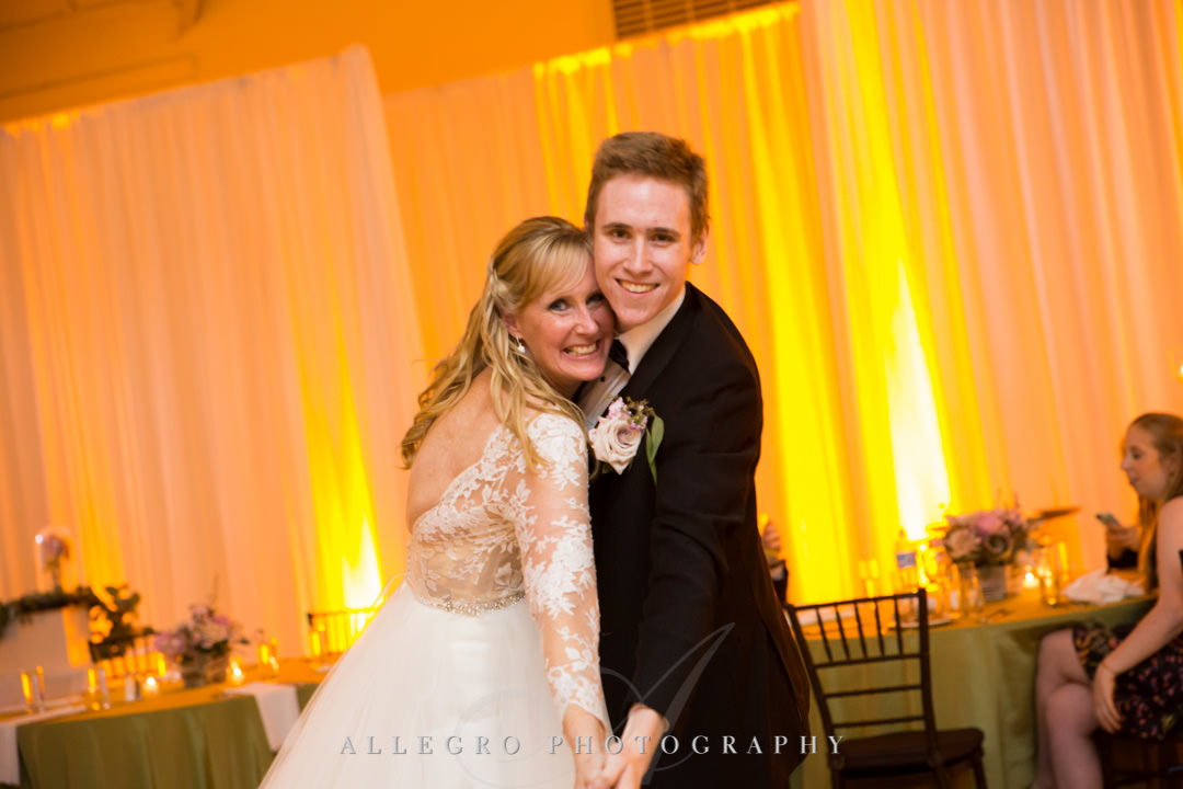 Bride poses with son on dancefloor | Allegro Photography