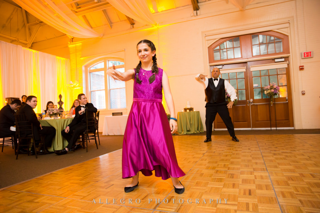 Groom and daughter perform silly dance at wedding | Allegro Photography
