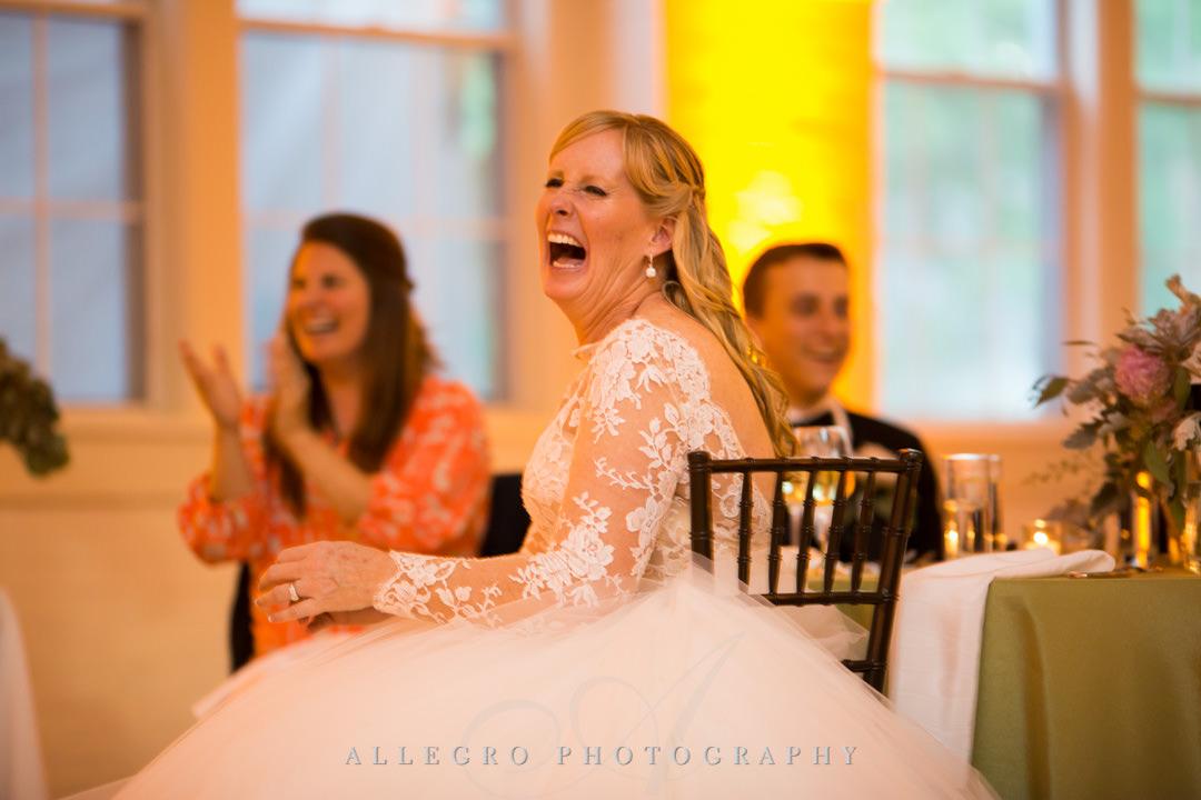 Bride laughs seeing her groom on dance floor | Allegro Photography