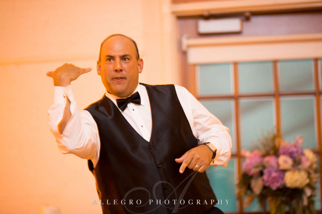 Groom does silly dance move | Allegro Photography
