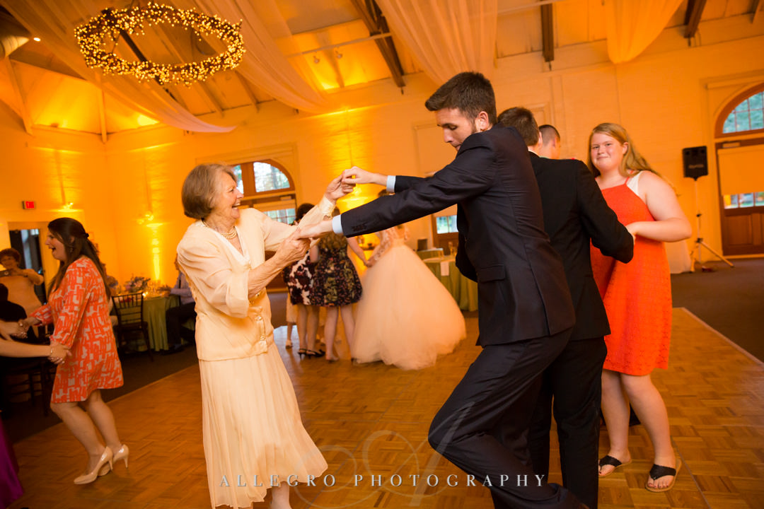 Grandma dances with grandson at wedding | Allegro Photography