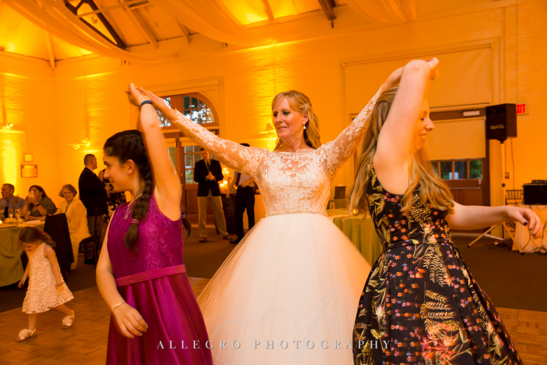Bride dances with daughters at wedding | Allegro Photography