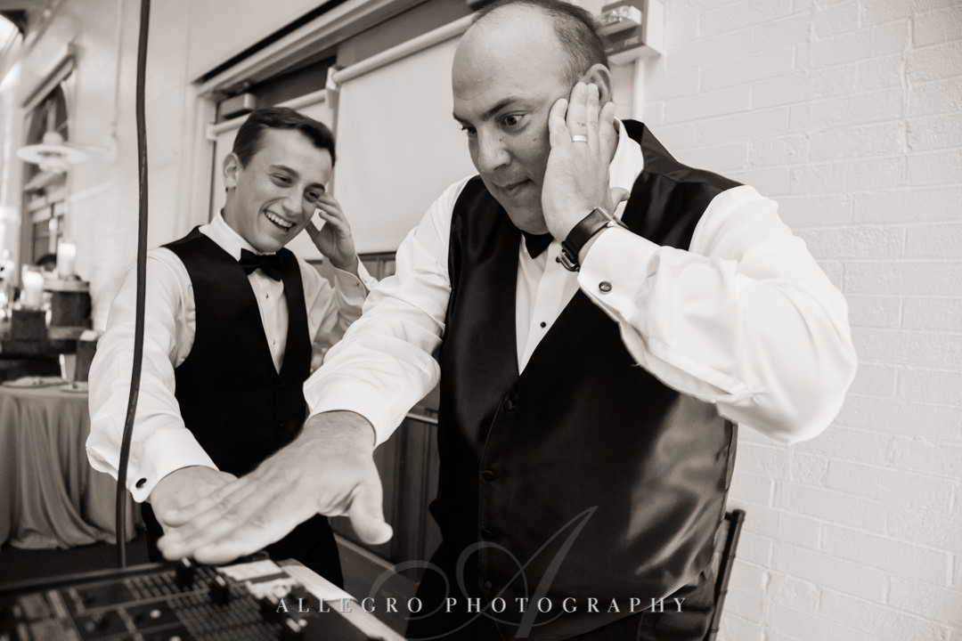 Groom and teenage son play DJ at wedding | Allegro Photography