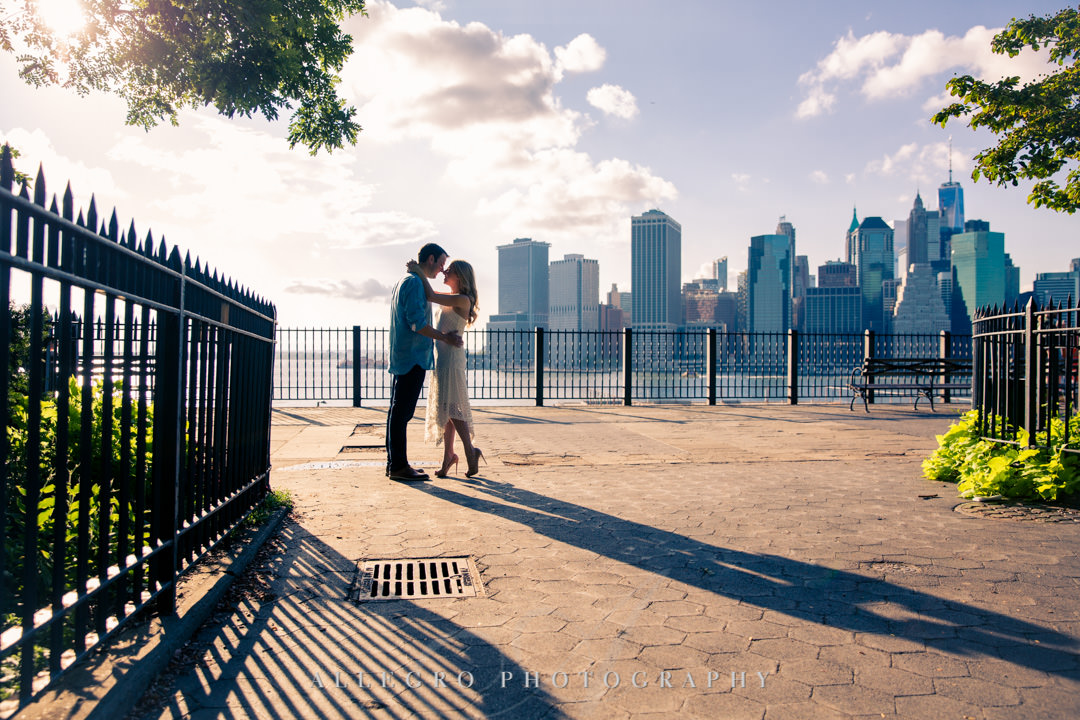 Couple in love standing against NYC skyline | Allegro Photography