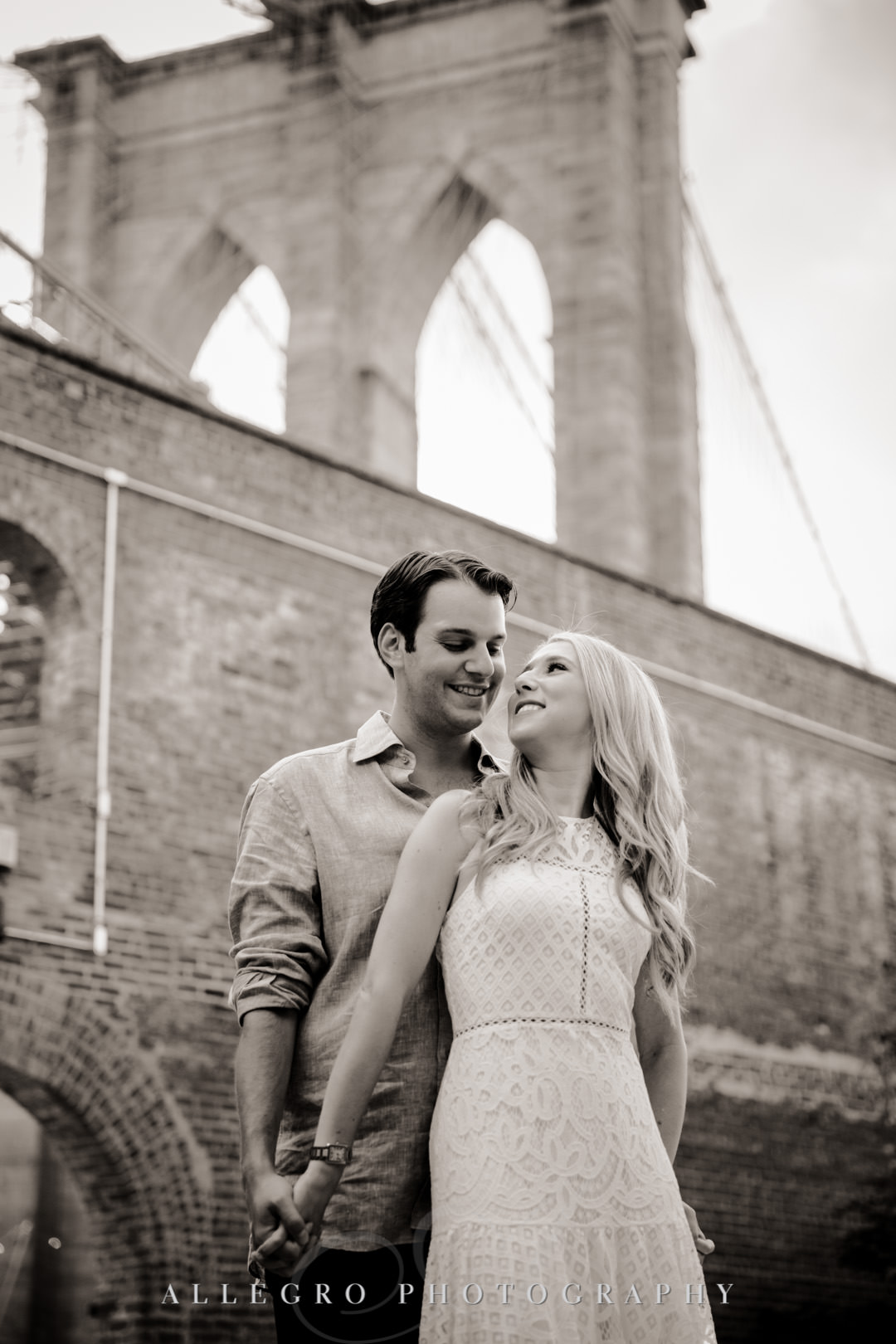 Engaged couple in front of Brooklyn Bridge | Allegro Photography