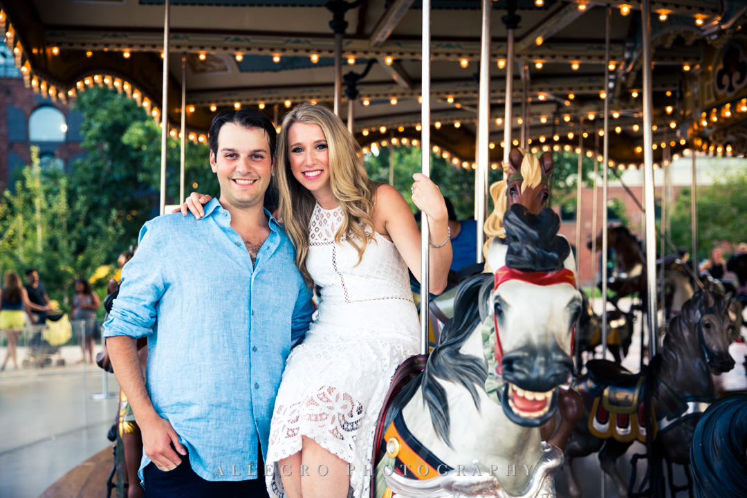 Engaged couple on merry-go-round in NYC | Allegro Photography