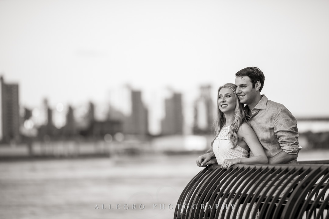 Fiancés looking out into New York City | Allegro Photography