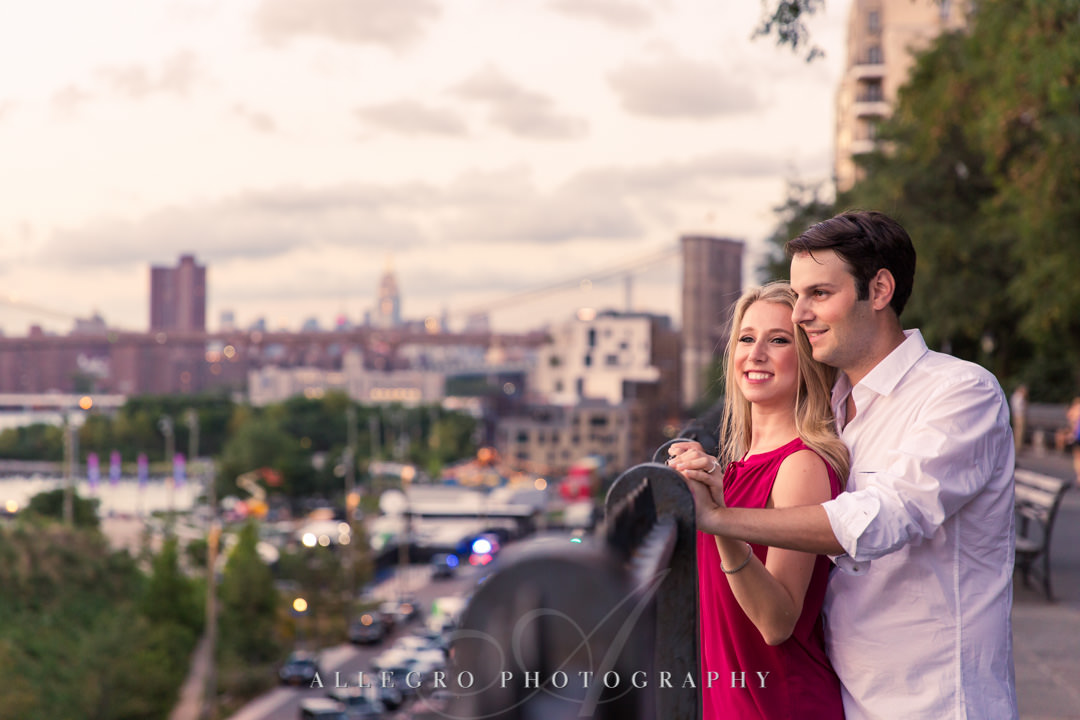 Young NYC couple staring out at city | Allegro Photography