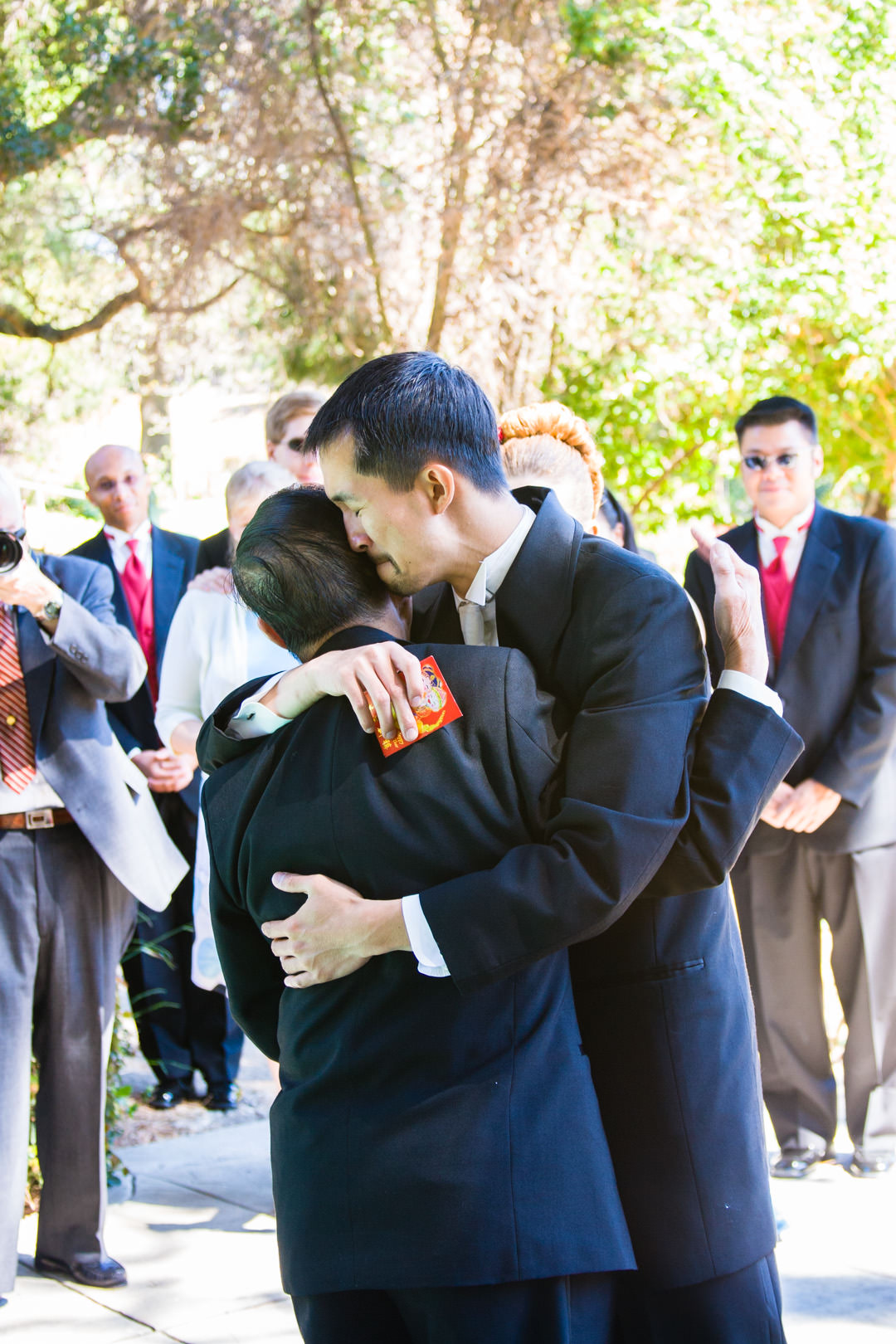 Groom hugs his father before wedding
