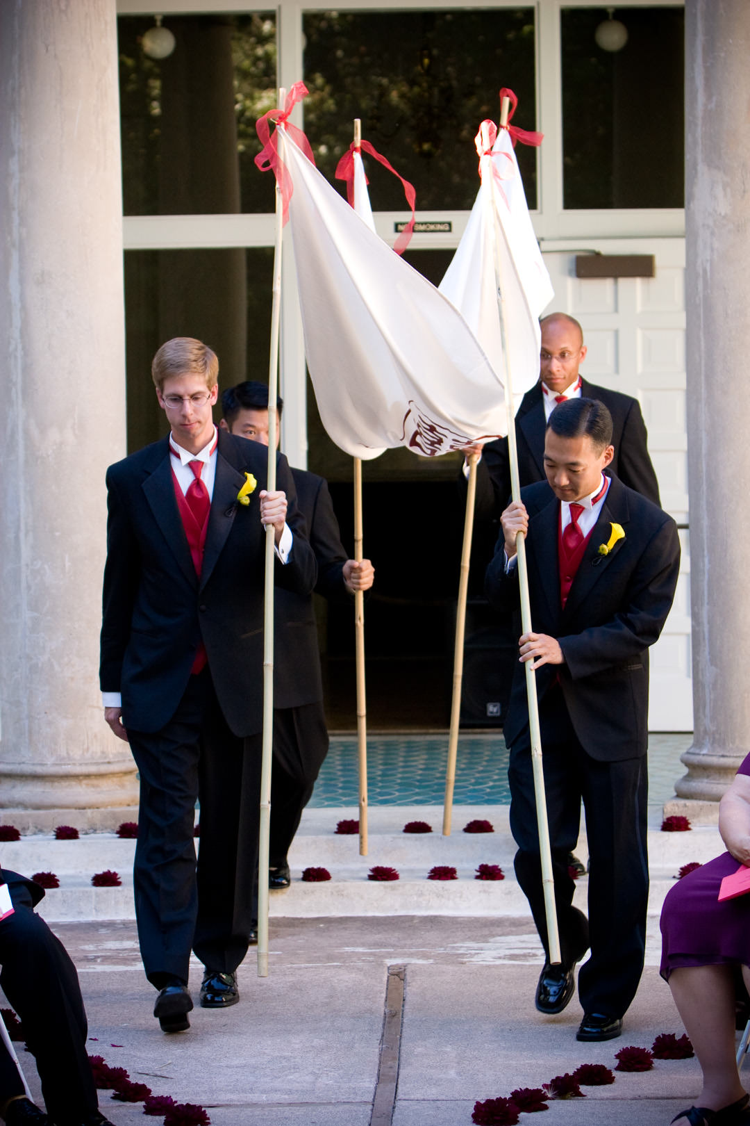 Groomsmen carry chuppah before wedding