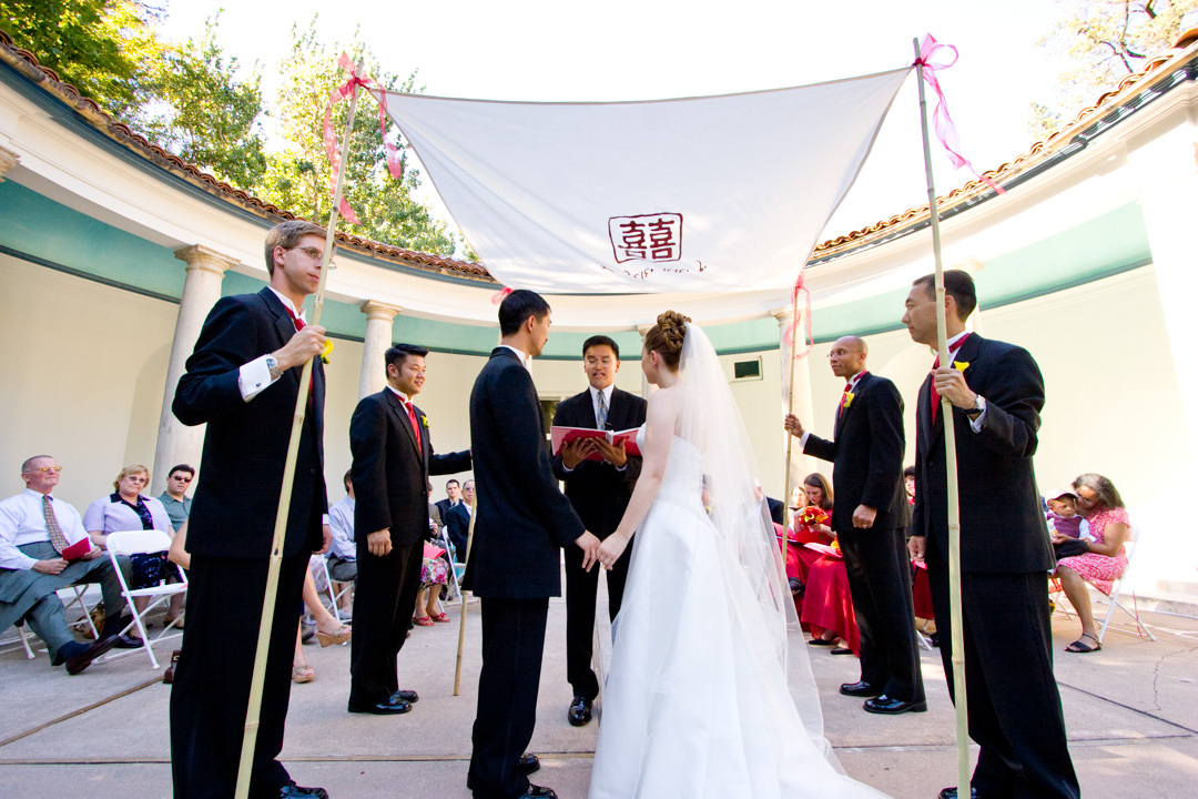 Bride and groom marry under Chinese chuppah