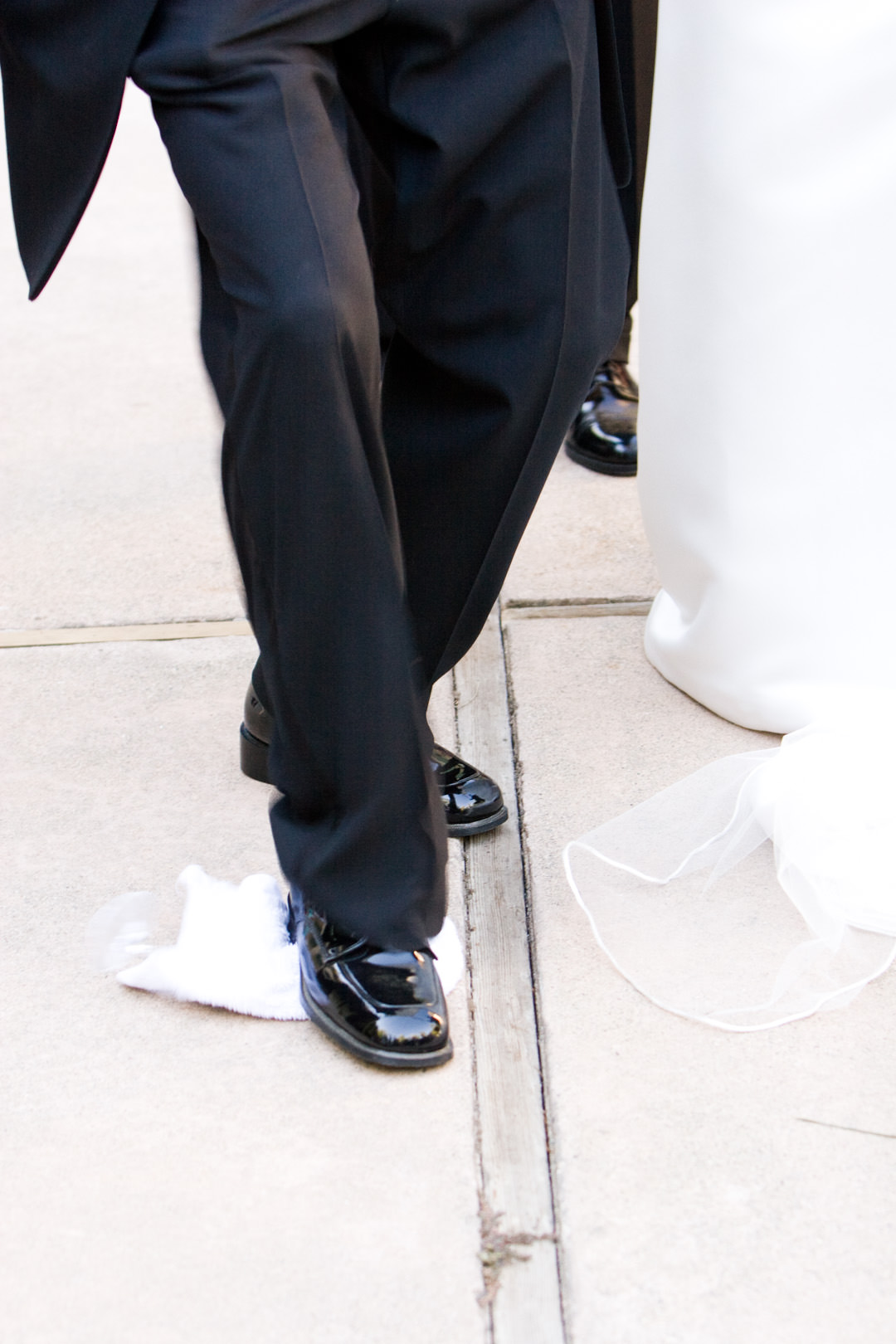 Groom stomps the glass at wedding