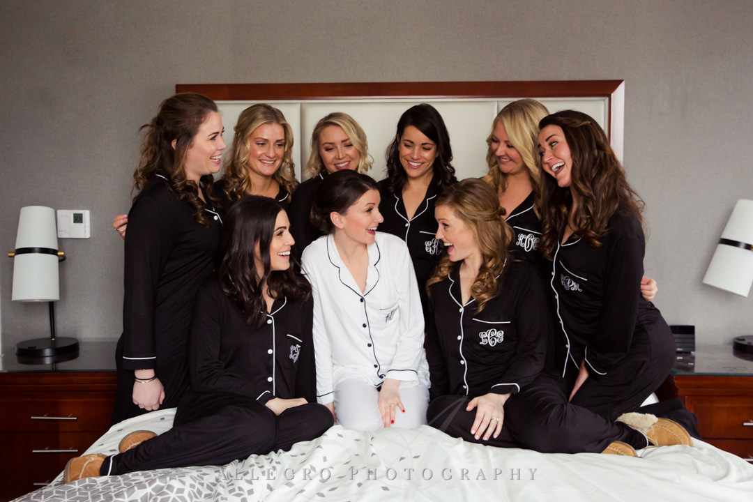 Brides laugh with her bridesmaids