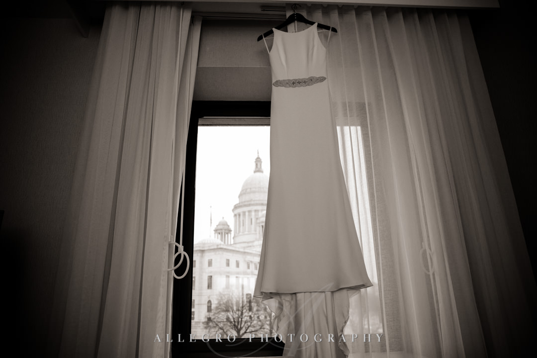 Wedding dress hangs in hotel