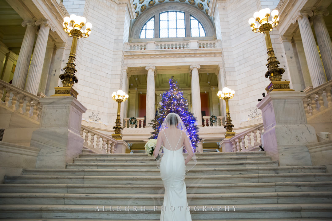 rhode island state house wedding - Bride climbs grand staircase to get first look at her groom
