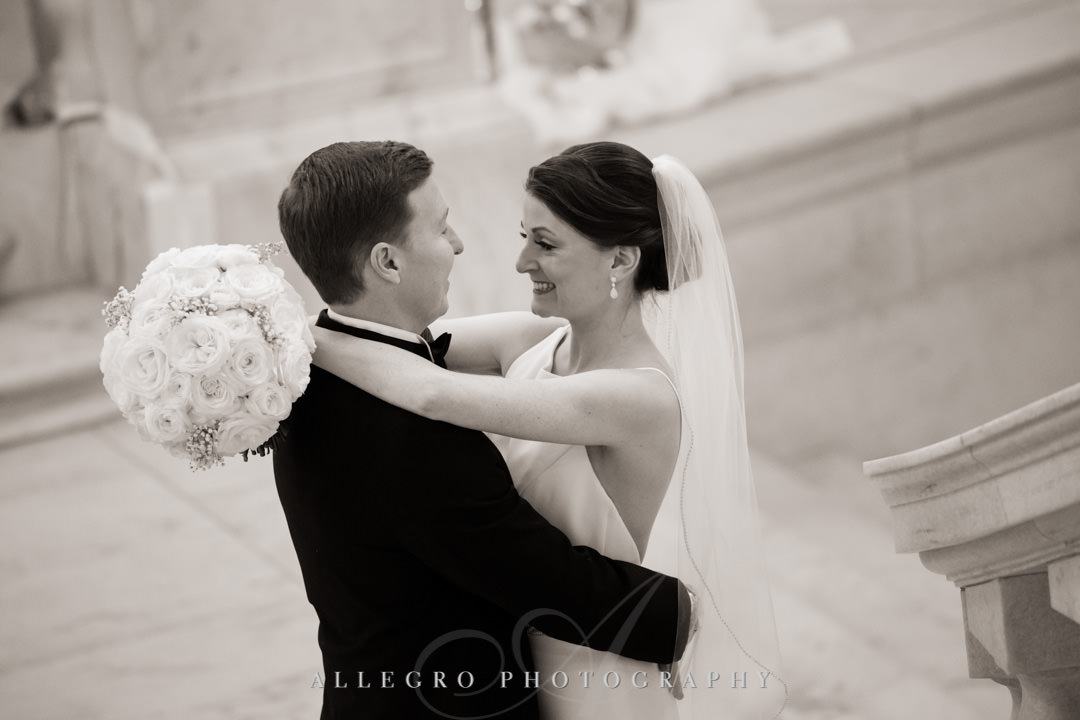 Bride and groom embrace before wedding